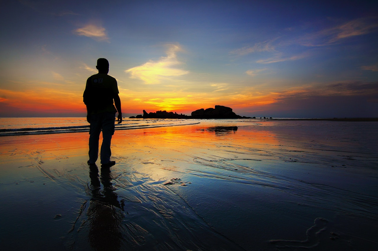 a man at the beach/going to the beach alone